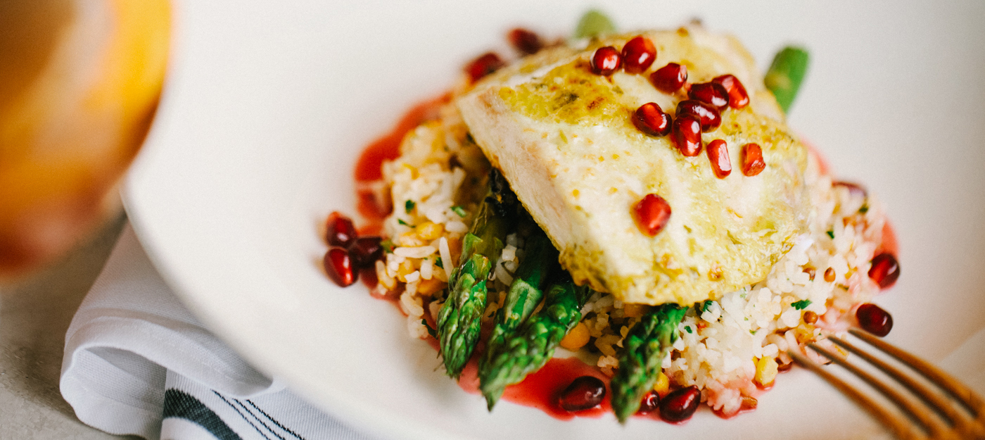 Fish and rice with pomegranate seeds