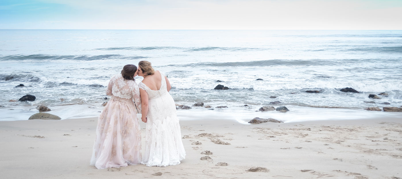 Two brides on the beach after wedding
