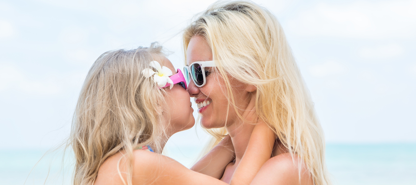 Mother and her daughter on the beach together
